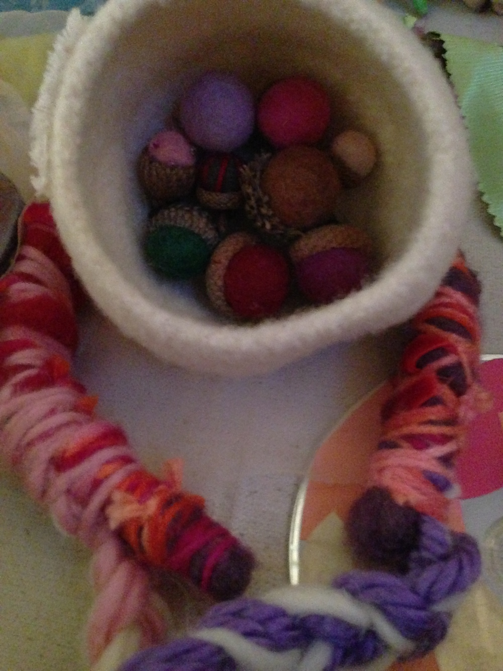 Kristin made felted acorns in a felted bowl! Fun, natural, colorful. Elisha and her daughter Sophia crafted a felt and yarn headband with braided strands.