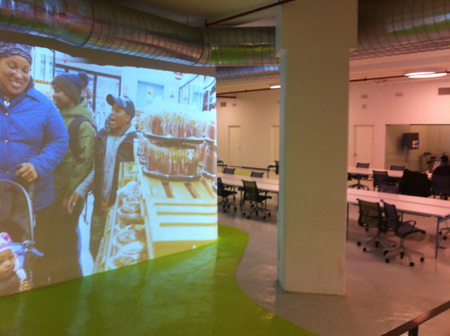 Invisible Child (NYTimes) Photo essay projected onto wall at Made in NY Media Center. The projections in the space are ever-changing.