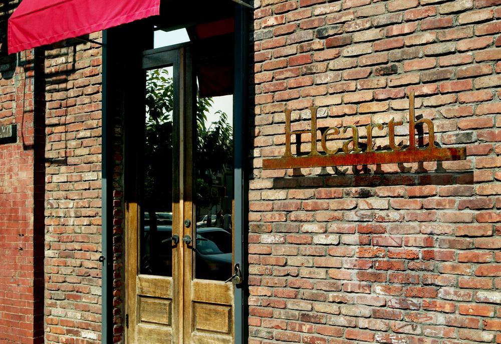 michael_daniel_metal design sign for Hearth restaurant james beard award nominee nyc date night restaurant idea