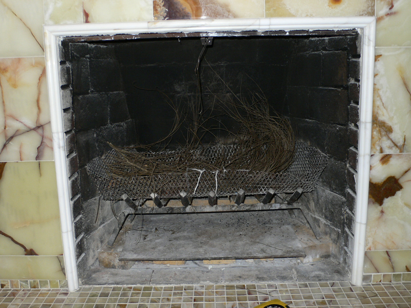 Fireplace before screen.
