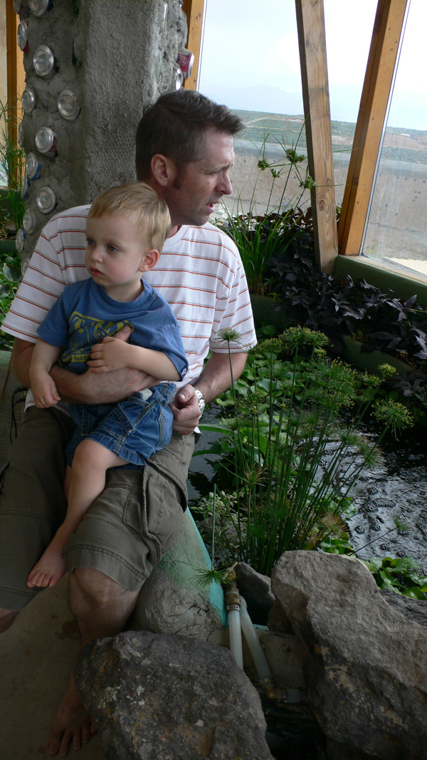 Me and Silas, sitting next to the tilapia pond