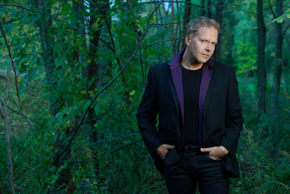 Niagara Symphony Orchestra conductor Brad Thachuk photographed in the woods