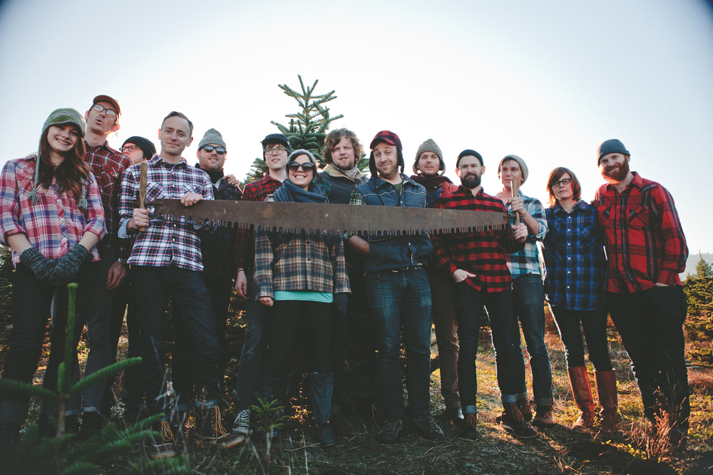 The Marmoset Family  [from left to right]: Kat Olsen, Ron Lewis, Justin DeMers, Bob Werner, Ryan Wines, Tyler Nordby, Sarah Buchanan, Eric Nordby, Stirling Myles, Jon Haas, Rob Dennler, Shane Geiger, Amy Hall, Brian Hall. [Brandon Day not pictured]