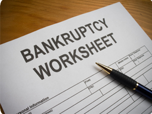 A bankruptcy worksheet with a pen