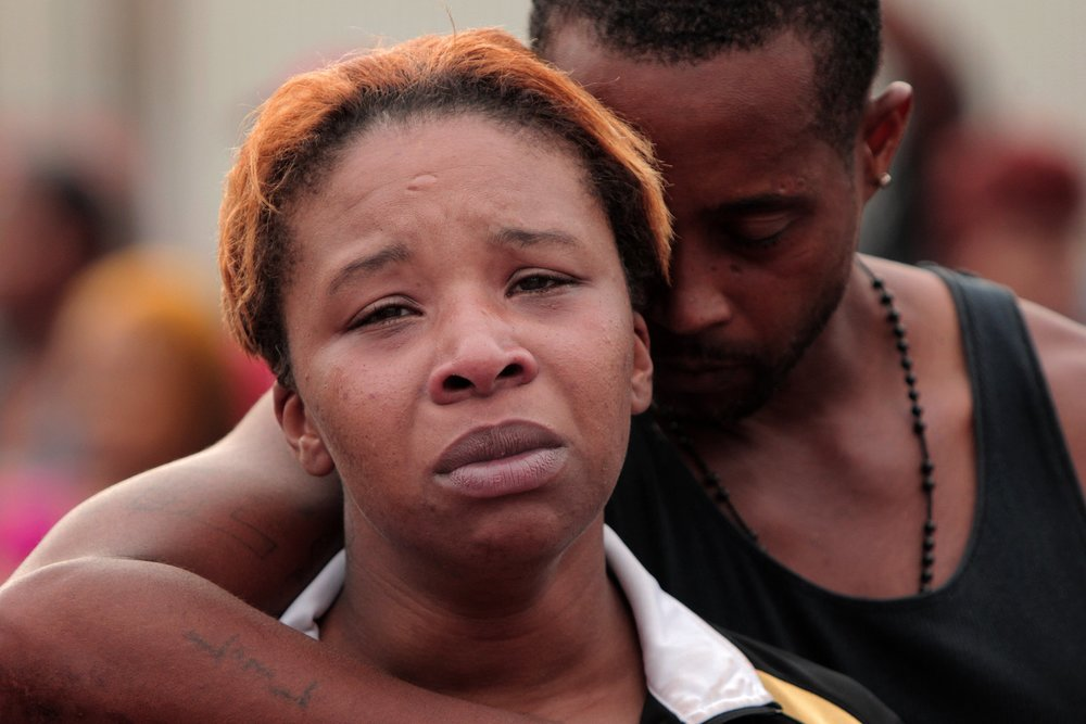 Lesley McSpadden is comforted by her husband, Louis Head, after her 18-year-old son was shot and killed by police earlier in the afternoon in the 2900 block of Canfield Drive on Saturday, Aug. 9, 2014, in Ferguson. Head is the step-father.   Photo by Huy Mach, hmach@post-dispatch.com
