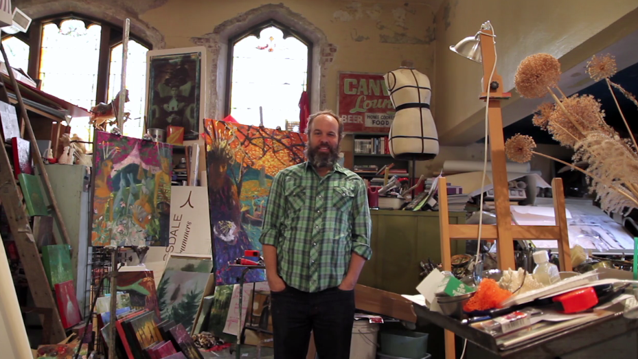 Artist Kyle Ragsdale stands in his studio at the Harrison Center for the Arts in Indianapolis. Photo by Pam Allee, courtesy of Harrison Center for the Arts