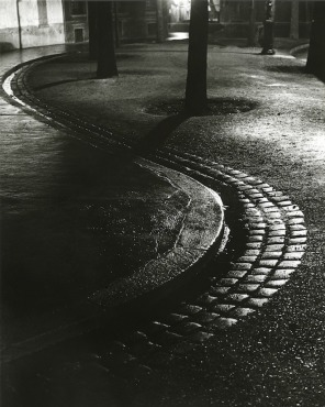 The stream snaking down the empty street, 1930-32