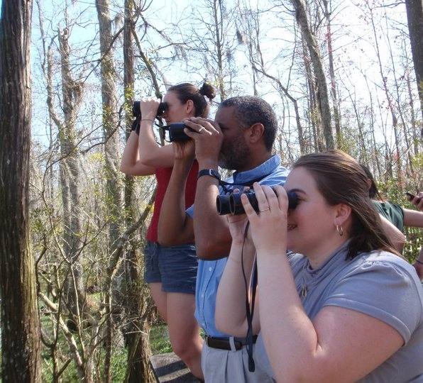 Birding with Dr. Scott Edwards in Louisiana! Pictured is me, Dr. Edwards, and Malorie Hayes. Photo by: Katie Sternberger