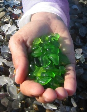An example of green seaglass collected on a beach of sea glass. Beautiful trash. Image from www.sandkuhler.com