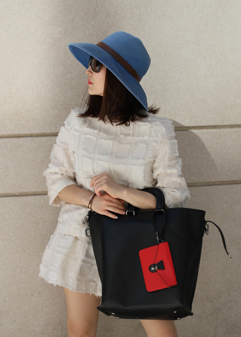 black leather tote with red pouch.jpg