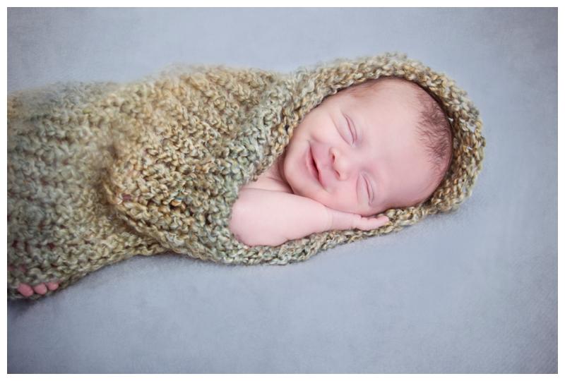 baby cacoon snug as a bug smiles.jpg