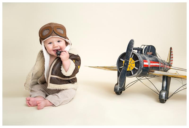 6 months airplane pilot baby.jpg