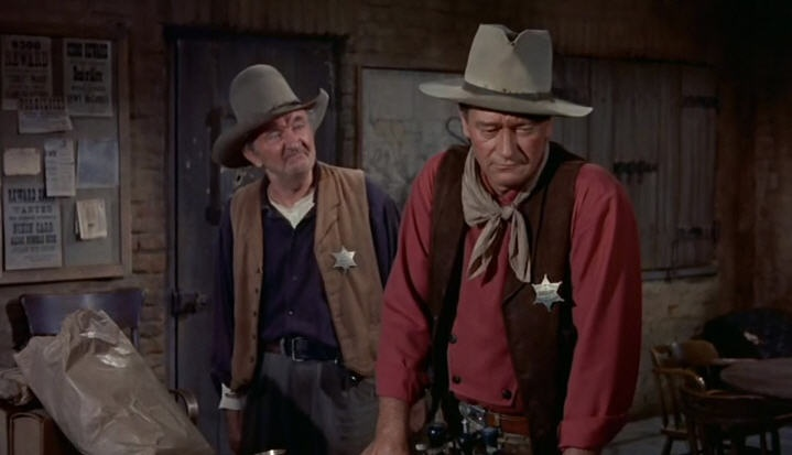 Walter Brennan and John Wayne in  Rio Bravo