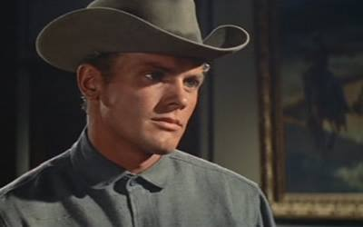 Tab Hunter as Ed Hackett in Gunman's Walk whistles a tune from the song 'I'm a Runaway' composed by Fred Karger and Richard Quine heard predominately throughout the film.