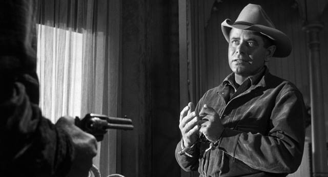 Glenn Ford as Ben Wade in 3:10 to Yuma (1957) whistles the main theme of George Duning's title music.