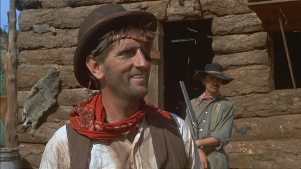 (In foreground) Harry Dean Stanton