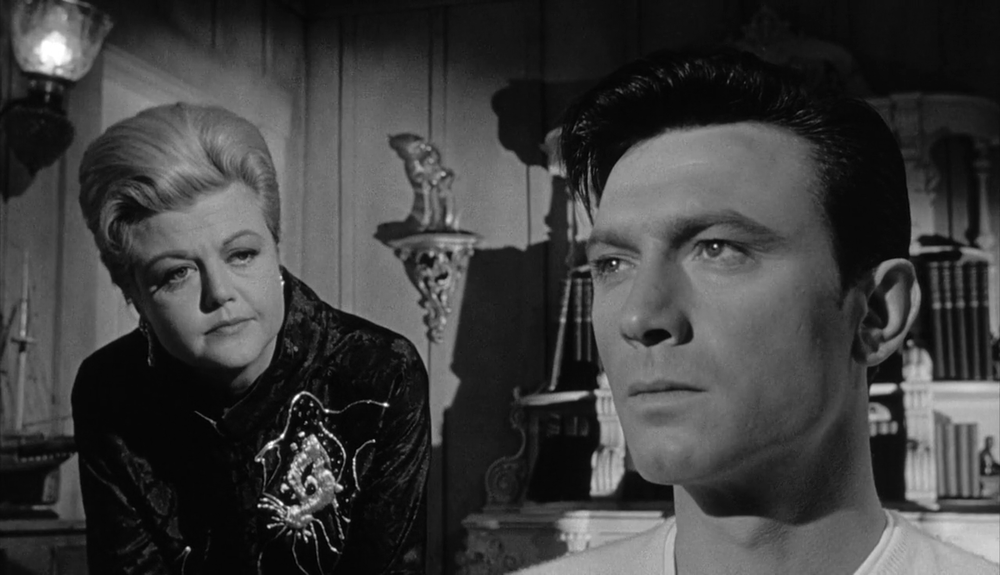 Angela Lansbury as Mrs. Eleanor Shaw Iselin with Laurence Harvey as Raymond Shaw in  The Manchurian Candidate