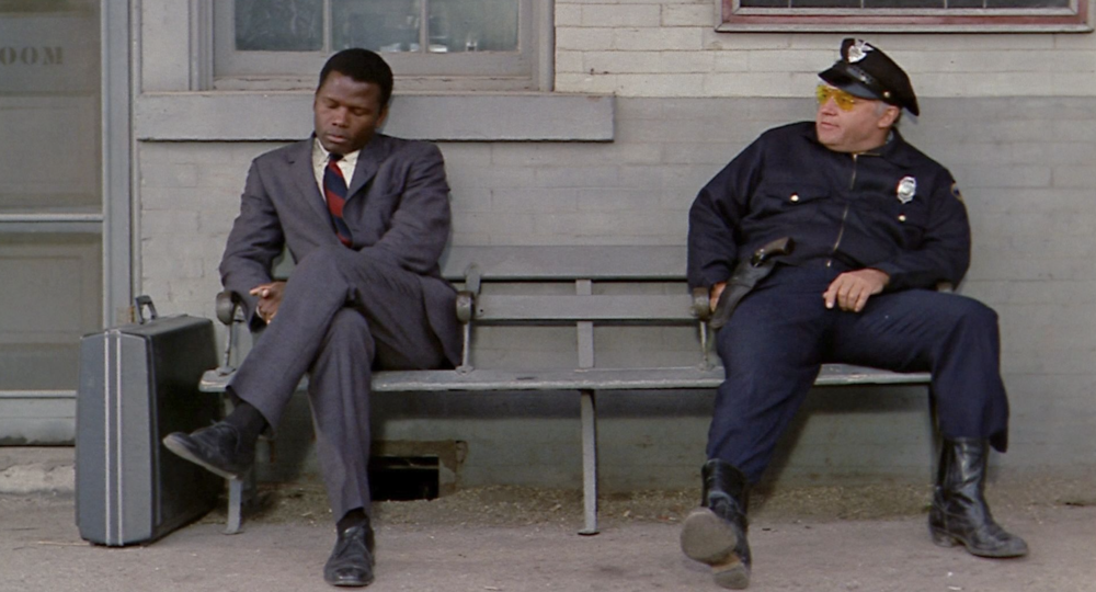 Sidney Poitier as Virgil Tibbs (at left) with Rod Steiger as Gillespie in  In the Heat of the Night