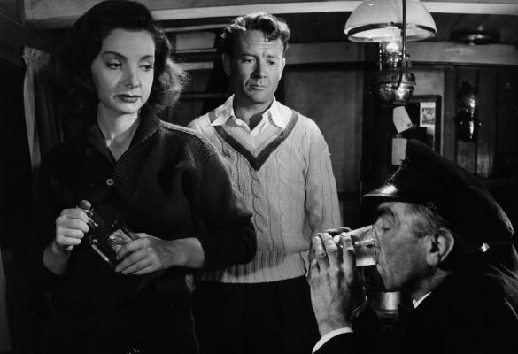 Elizabeth Sellars as Fay Lowther with John Mills as Phillip Davidson (centre)and Fred Johnson as Captain Driver in  The Long Memory