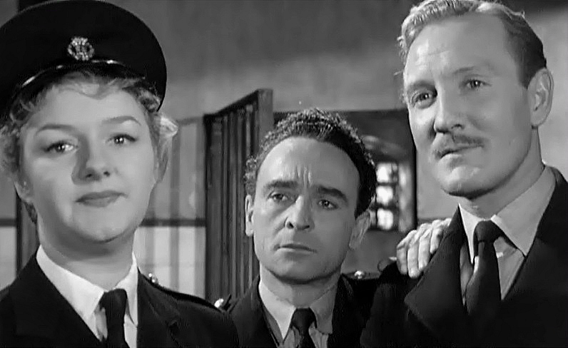 Leslie Phillips as PC Tom Potter (at right) with Joan Sims as WPC. Gloria Passworthy and Kenneth Connor as PC Charlie Constable (centre)in  Carry On Constable
