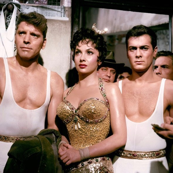Gina Lollabrigida as Lola with Burt Lancaster as Mike Ribble (at left) and Tony Curtis as Tino Orsini in  Trapeze