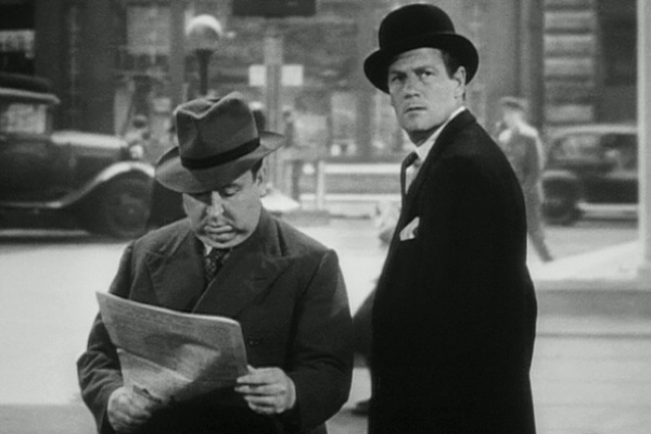 (From left) Some guy reading a newspaper, Joel McCrea