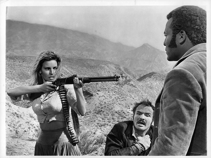 "Raquel Welch, Burt Reynolds, and Jim Brown in ""100 RIFLES"""