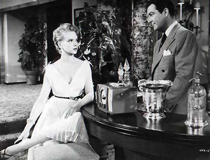 Anne Francis as Nancy Corlane with Robert Taylor as Christopher Kelvaney in  Rogue Cop