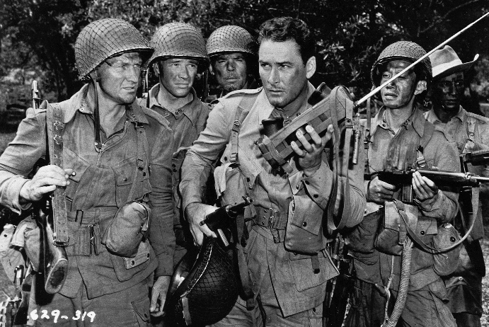 Dick Erdman (second from left) with Errol Flynn (holding radio) in OBJECTIVE, BURMA!