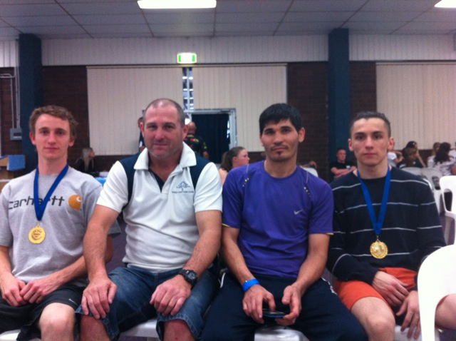Medal winners in Boxing NSW State Novice Titles. (l to r) Beau White, Novice Welterweight champion, Coach Greg Stanton, coach Asghar Ali Shah, James Robinson Novice light welterweight champion.