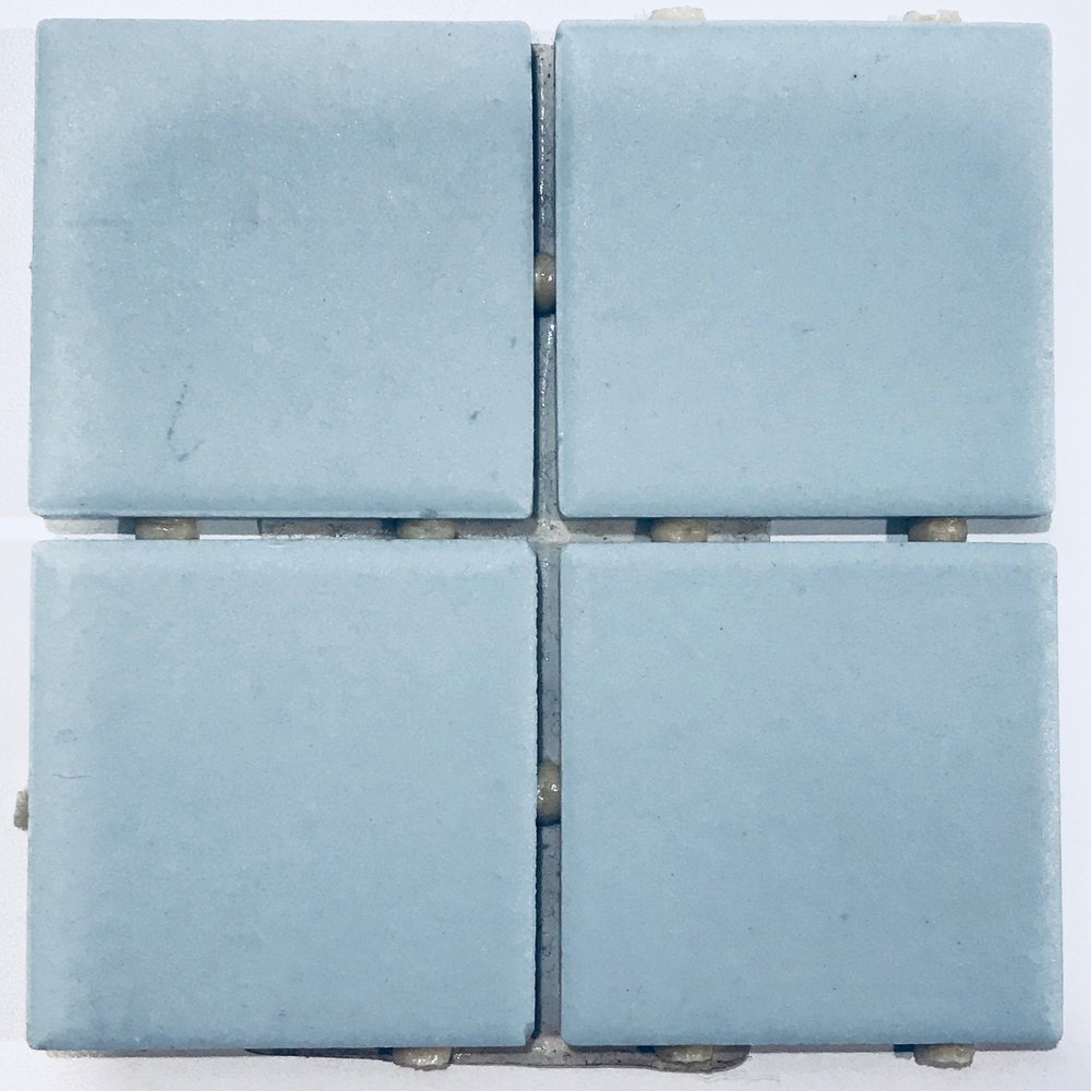 MATTE LIGHT BLUE TILE FROM AMERICAN OLEAN. 2 X 2 INCH TILES FOR WALLS AND FLOORS OF GUEST BATHROOM -