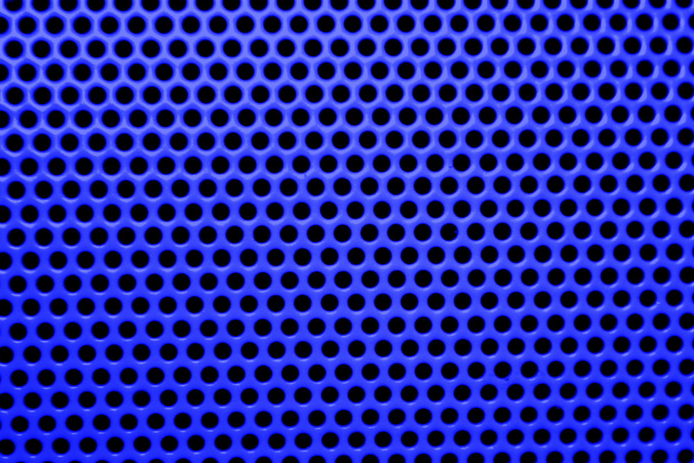 CLOSE UP OF PERFORATED METAL SHEET