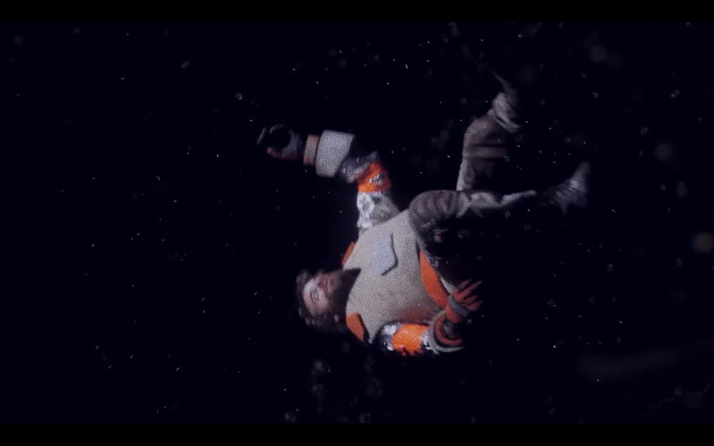 "Still from ""XXXO"" - Justin Johnson as Space Cowboy floating through space"
