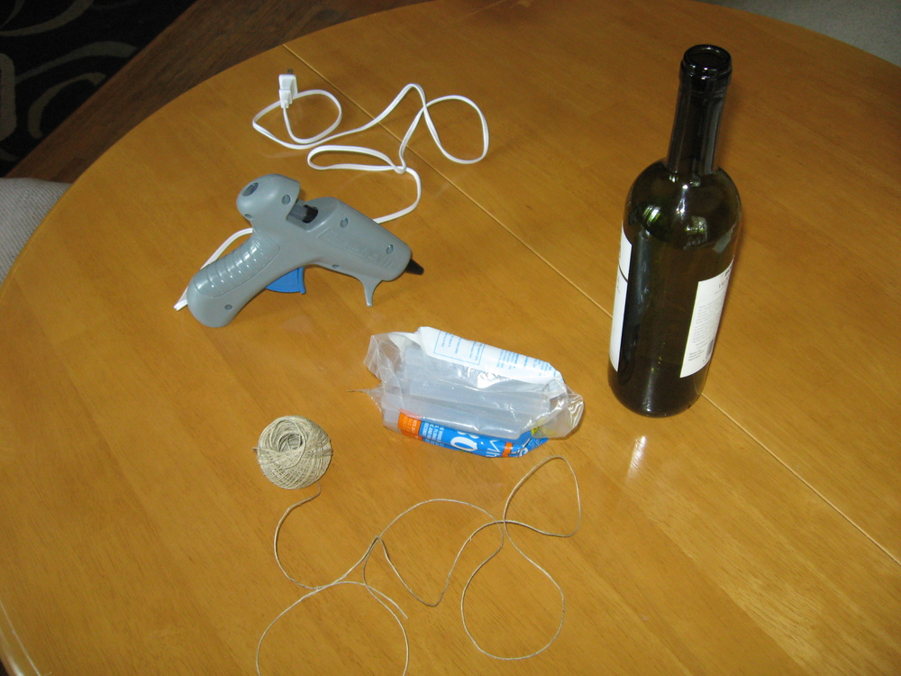 Supplies: Glue gun, wine bottle and hemp. That's it!