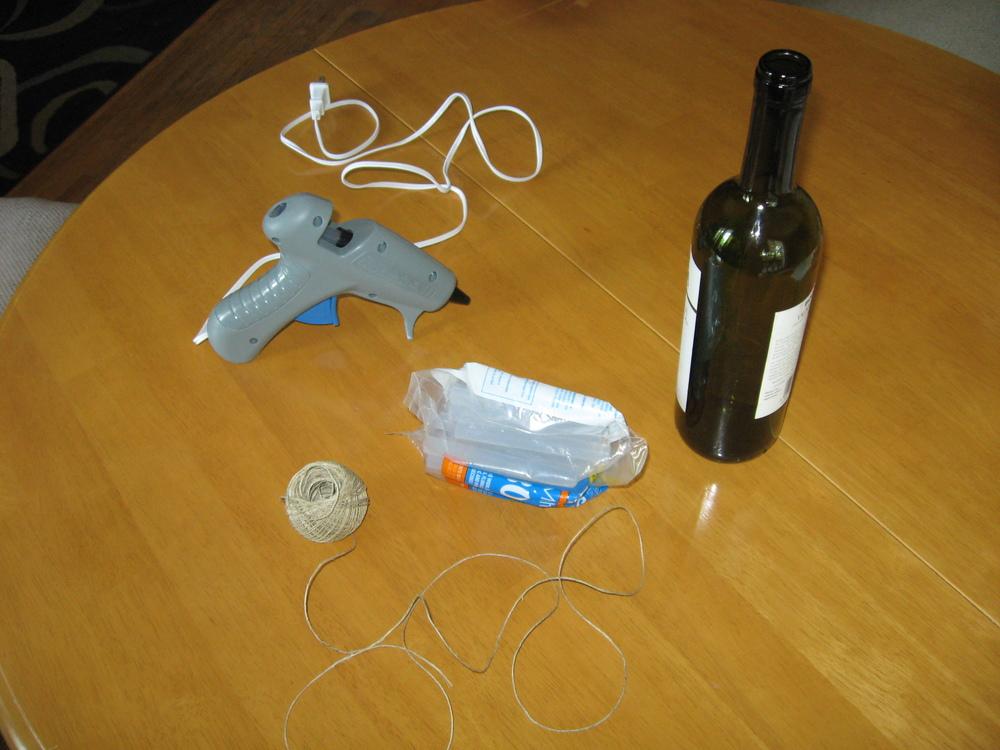 Supplies: Glue gun, wine bottle and hemp. That's it!