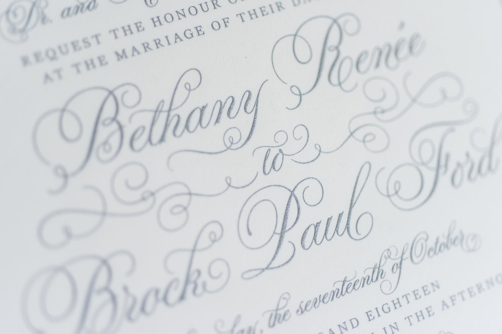 Close-up of engraved text. Photo Cred: Laura Graham. Invitation by Roxy Lou.