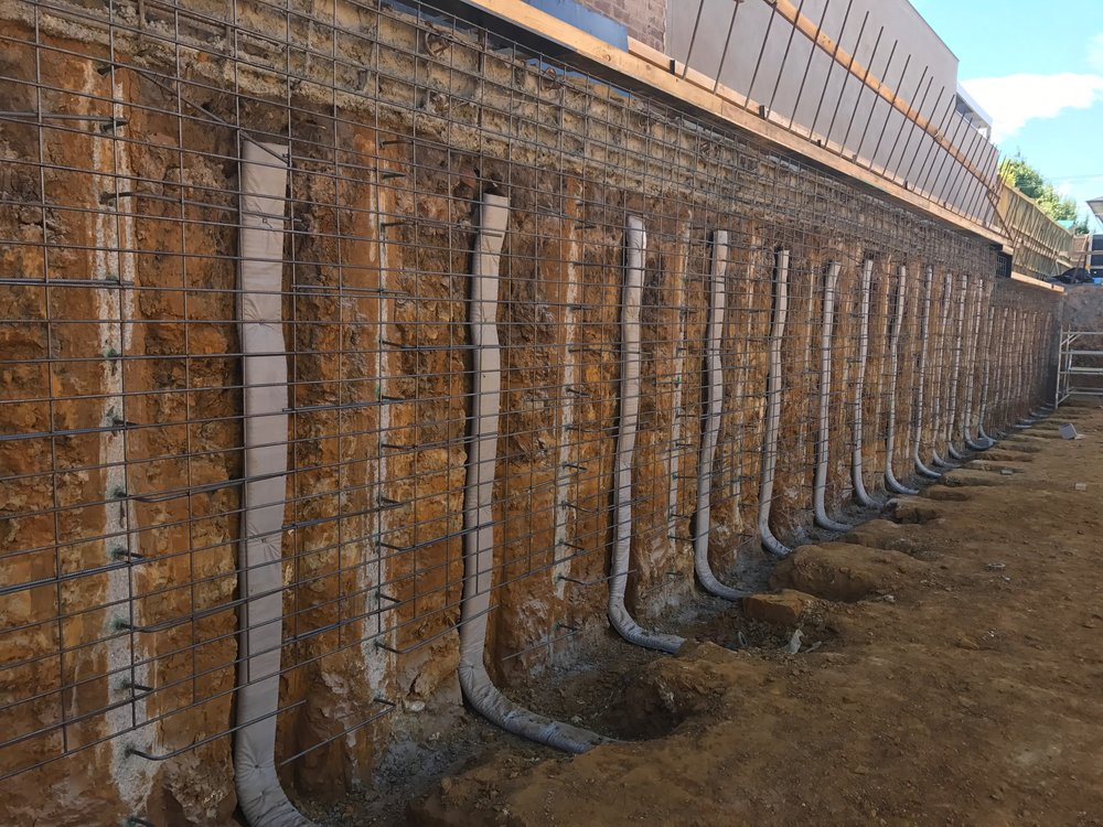 Here we have placed strip drain in between the concrete piling, this will create the necessary void and drainage behind the shotcrete walls.