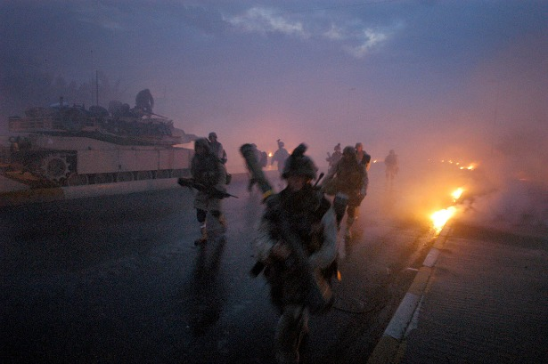 Marines run for cover after white phosphorus was accidentally fired at them by another company in Falluja, Iraq on November 9, 2004.[Ashley Gilbertson / VII]