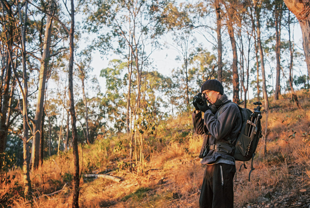 Nick shooting 35mm Kodak Ektar 100 on his Nikon FA with 28mm F2.8 AF-D lens. Photo by Nat Dash.