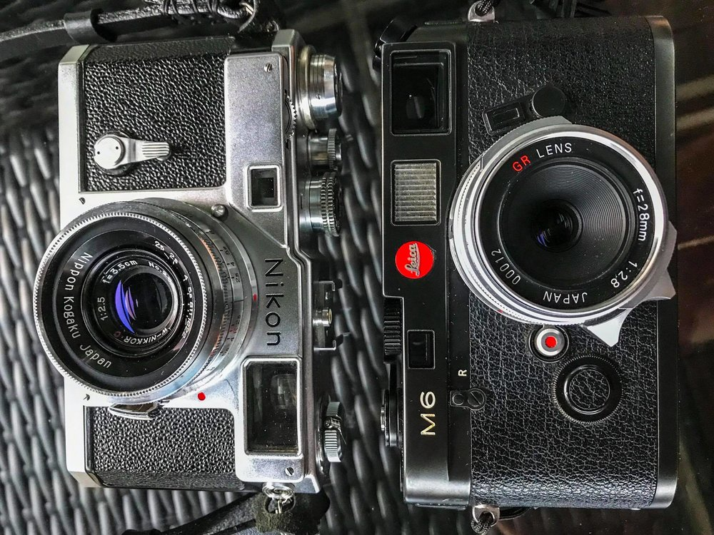 Nijon S3 next to the equally impressive Leica M6