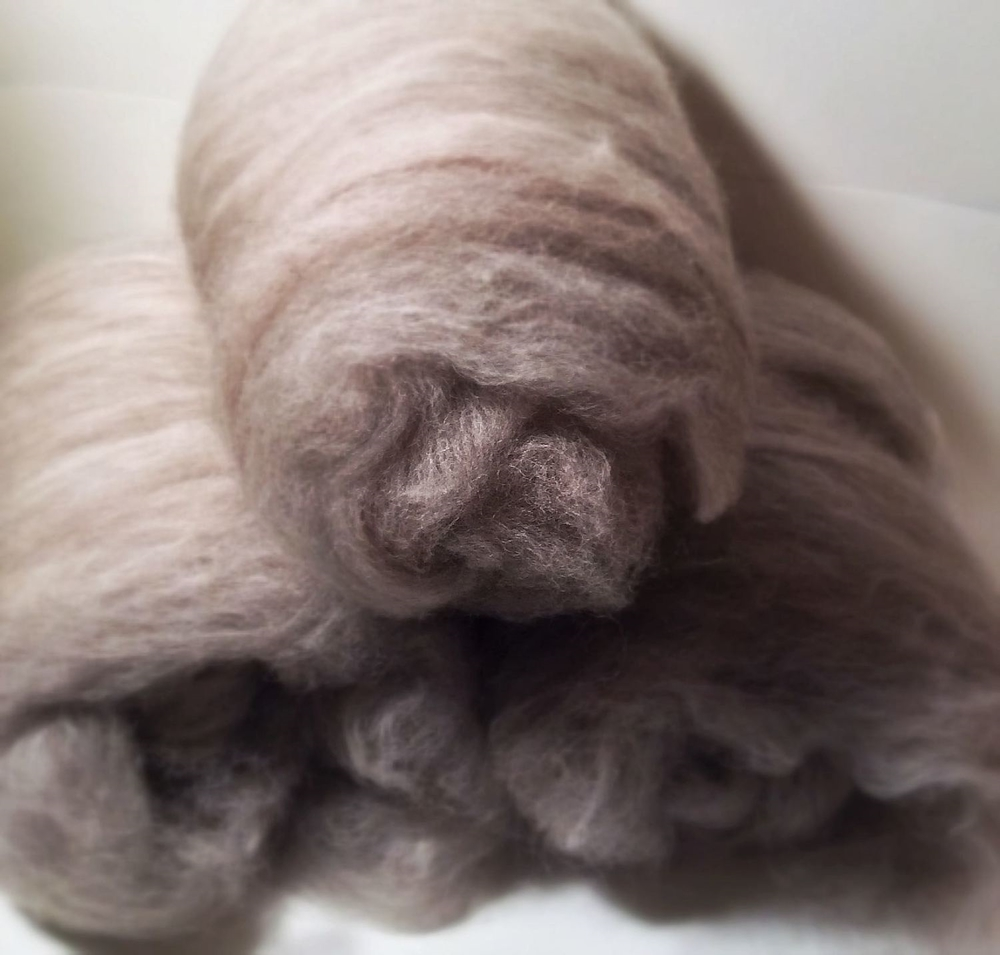 The carded batts, each roughly two ounces, and 70% alpaca with 30% superfine natural Merino wool.