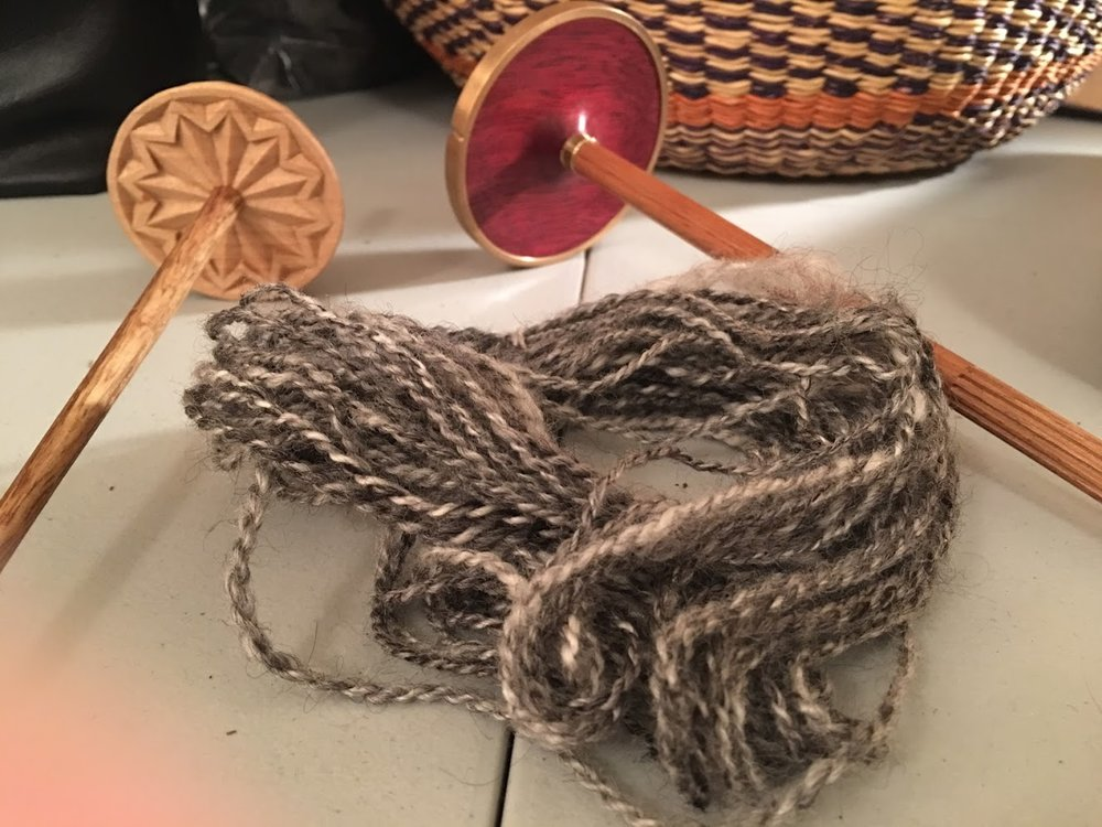 The finished sample of 70/30 Finn/alpaca yarn, spun on the left spindle and plied on the right one.