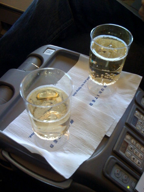 They're giving us champagne and the plane hasn't even taken off yet.