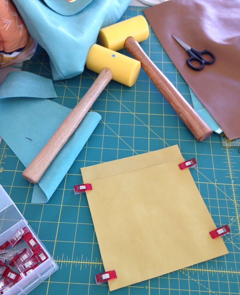 Using clips to pin the leather in place.