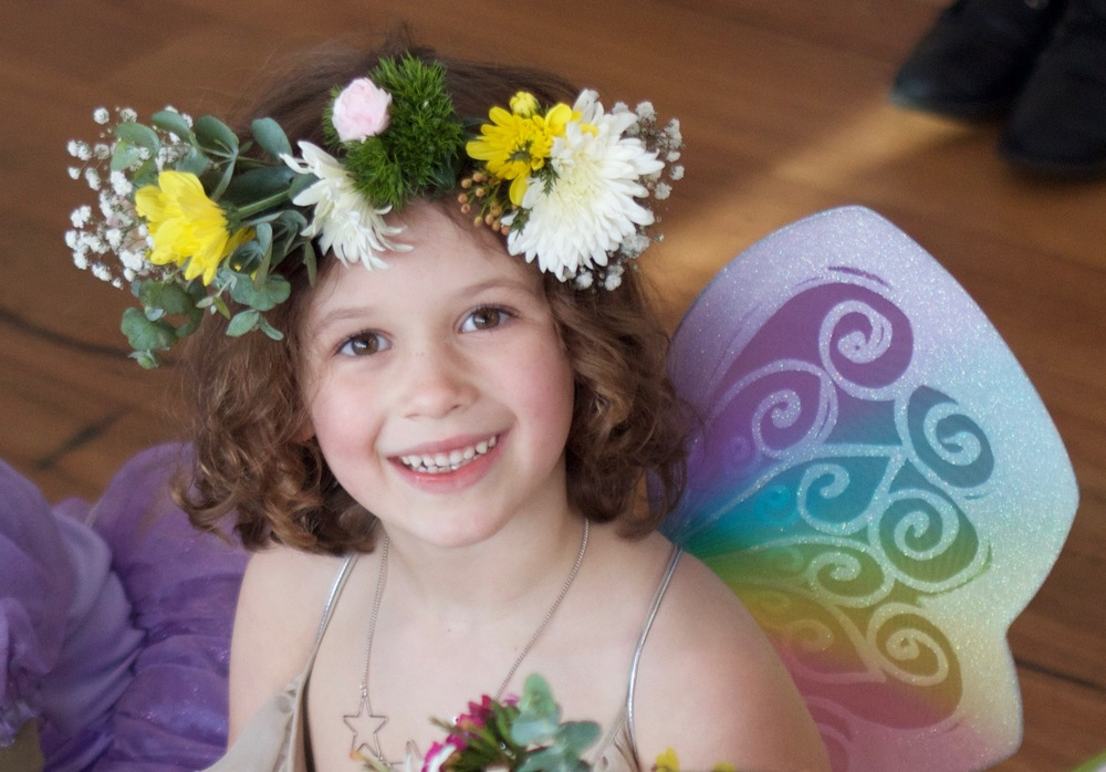 A happy little Birthday Fairy in her Flower Crown.