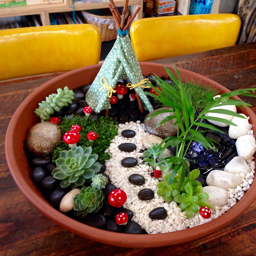 One of our little fairy's handmade birthday presents - her very own fairy garden.