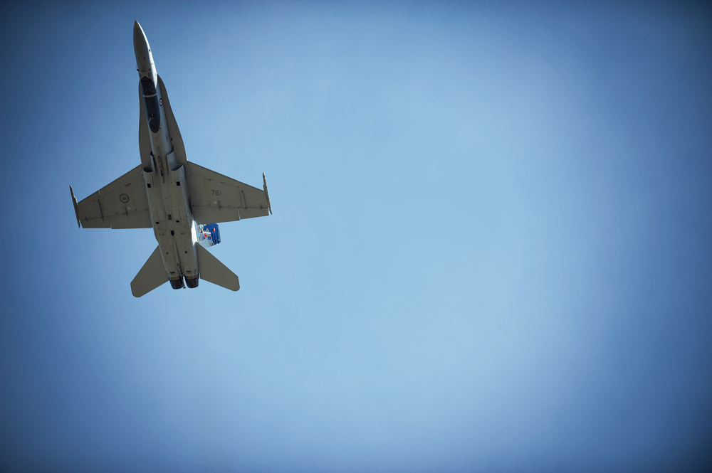 © Kevin Vyse Photography  All rights reserved 2014   F-18 Hornet comes flying straight over head just under the speed of sound