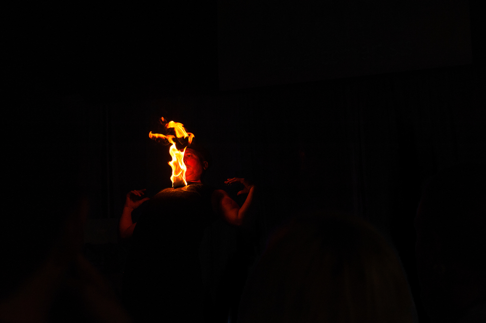 Fenyx Fyre holding a fire ball on his chest live on the RAW stage.