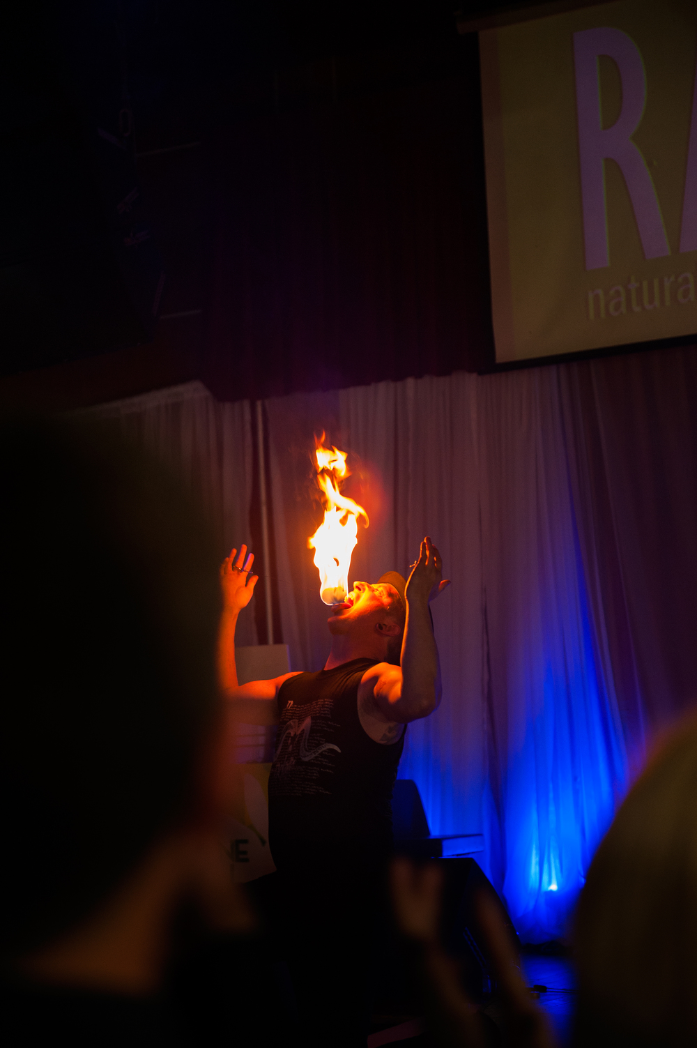 Fenyx Fyre displaying another fire ball, which he is licking on the RAW stage