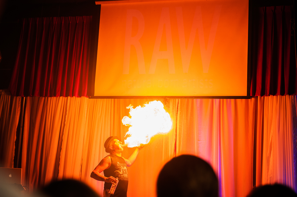Fenyx Fyre Blowing out a giant cloud of fire on the RAW stage.